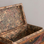 A rectangular leather clad studded box