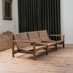 An elm, walnut and rush three seat sofa