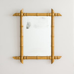 A pair of large rectangular faux bamboo mirrors
