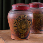 A pair of Victorian lidded earthernware tobacco jars