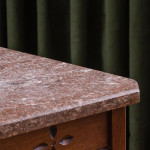 An unusual walnut Reformed Gothic occasional table with a granite top in the manner of Charles Locke Eastlake (1793 - 1865)
