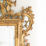 An exceptional and large giltwood Venetian mirror