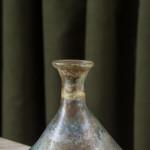 A small Roman iridescent glass bottle