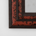 A  faux tortoiseshell wall mirror