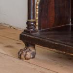 A faux bois Regency chiffonier with gilded lion paw feet