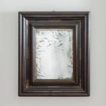 A large and fine Baroque ebonised walnut ripple frame mirror