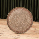 A cast iron circular bistro table by E.W. Depose