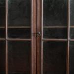 A small George III glazed mahogany wall cabinet