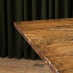 A large Baroque olive wood trestle table