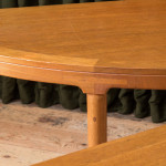 A low walnut centre table or pair of demi-lune consoles by Arne Karlsen (1927 - 2018)