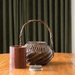 A woven split cane Ikebana basket