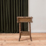 An unusual winged elm and woven rush work table