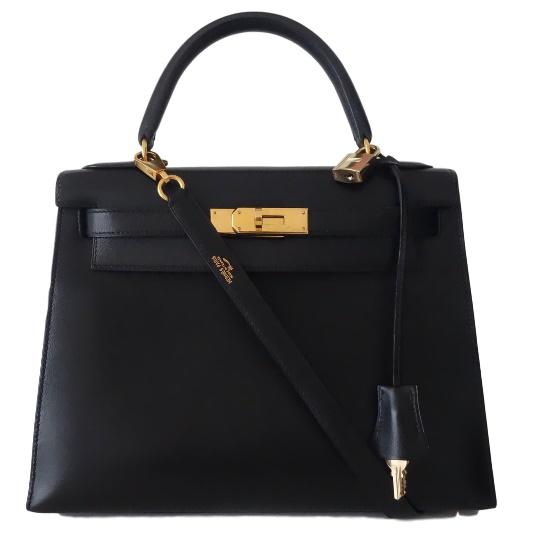 Une image contenant accessoire, boîtier, valise, noir  Description générée automatiquement