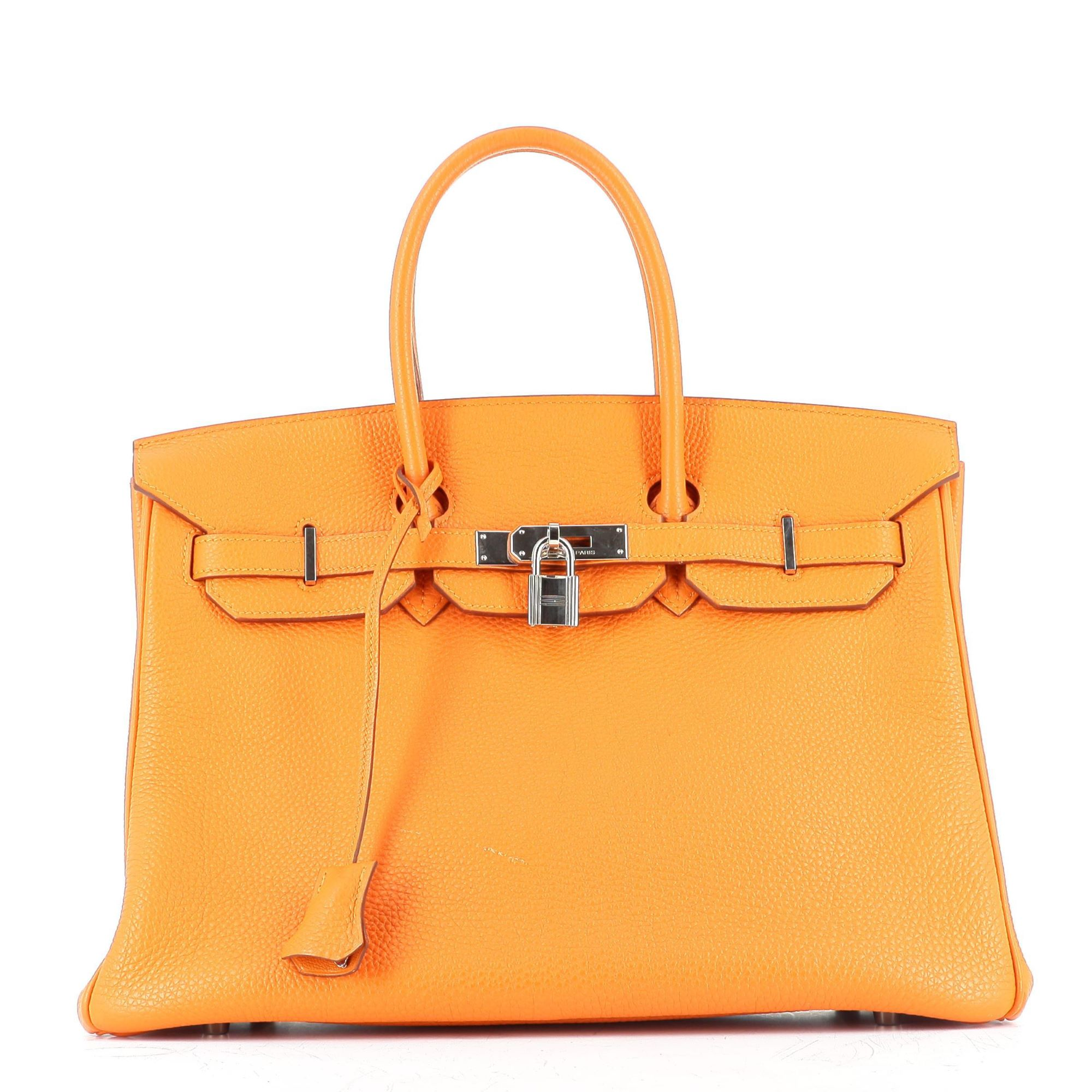 A picture containing accessory, bag, orange  Description automatically generated