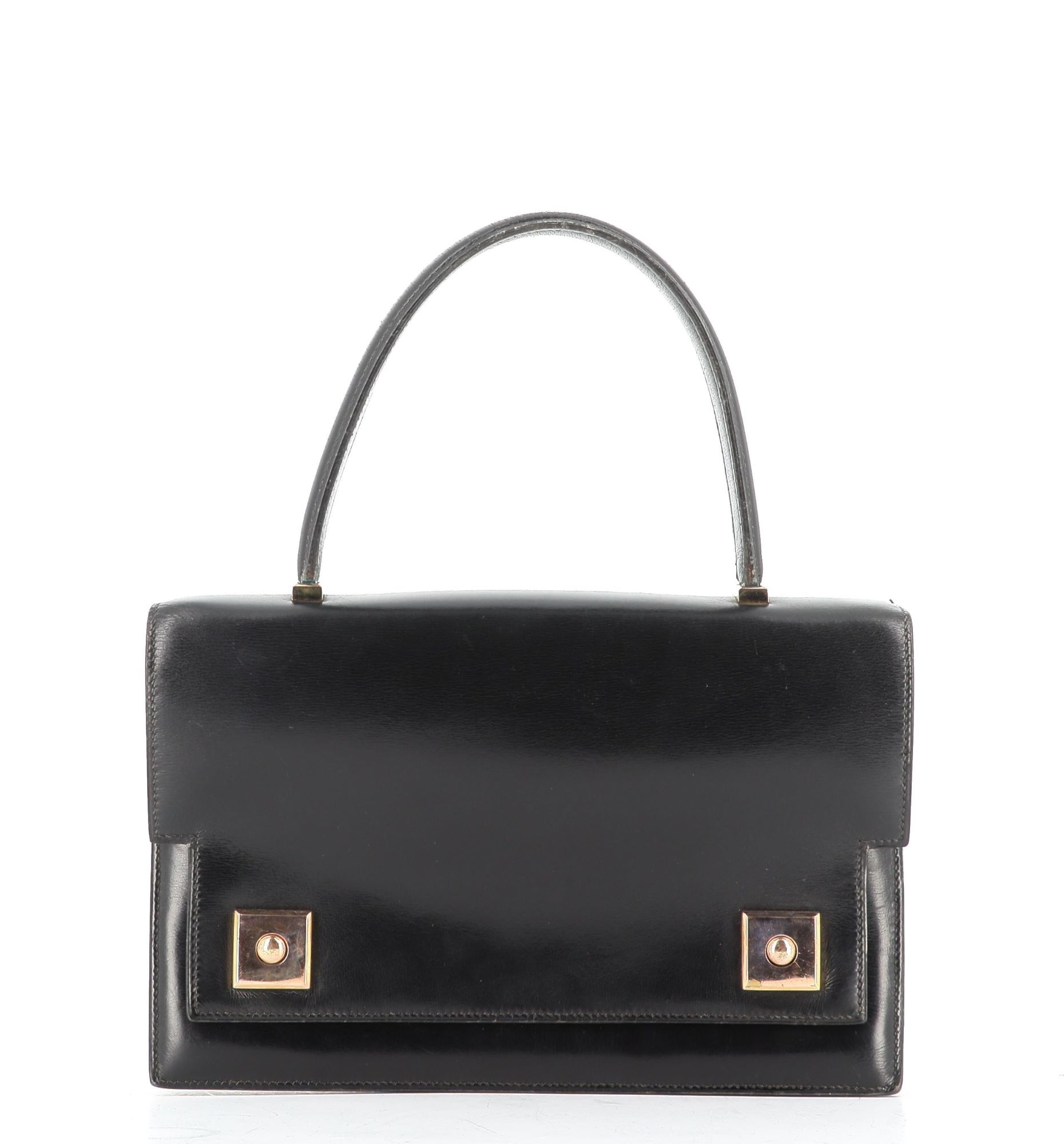 A black purse with a handle  Description automatically generated with low confidence