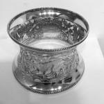A SILVER PLATED DISH RING OR POTATO RING CIRCA 1920
