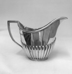 A SOLID SILVER THREE PIECE TEASET 1925/6
