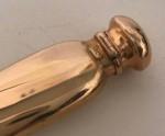 A GOLD CONCAVE PERFUME BOTTLE Circa 1910