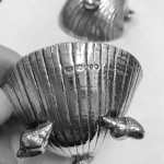 A PAIR OF VICTORIAN SILVER SHELL SALTS 1877