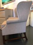 Large wing arm chair covered in linen union