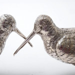 Pair of cast & hand chased silver model snipe