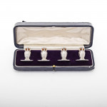 Set of four silver owl place card holders