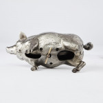 Rare silver-plated bell in the form of a hog