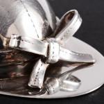 Silver jockey's cap caddy spoon