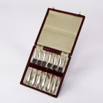 Six silver pastry forks