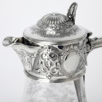 Victorian claret jug with engraved hunting scene