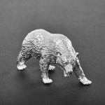 Silver grizzly bear model