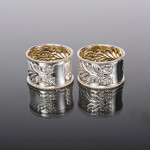 Pair antique embossed silver napkin rings