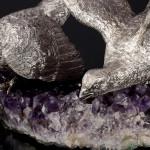 Pair silver pheasants on amethyst base
