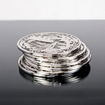 Silver overlay trivets with fishing scene