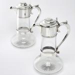 Pair Edwardian crystal & silver claret jugs