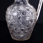 Pear-shaped cut-glass & silver claret jug