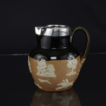 Royal Doulton water jug with silver mount