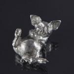 Silver pig model - lying back