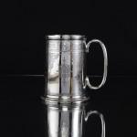Silver mug with sheep shearing inscription
