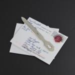 Dog-themed antique silver letter opener