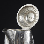 Engraved glass wine jug with silver mounts