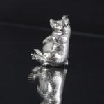 Silver pig - sitting back