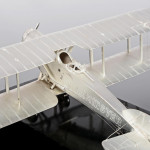 Silver model of WWI Bristol F.2B fighter plane