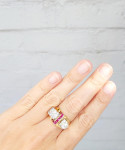 A Diamond & Ruby Buckle Ring