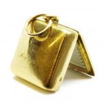 A Gold, Sapphire & Diamond Square Shaped Locket