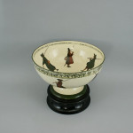 Vintage punch bowl by Royal Doulton with fishing scenes.