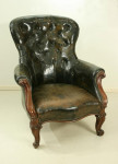 ANTIQUE LEATHER BUTTON BACK CHAIR.