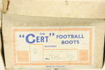 Pair of boxed football boots.