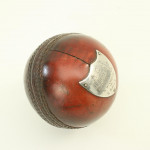 Cricket ball with silver plaque
