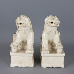 Pair of Blanc de Chine Buddhistic Lions